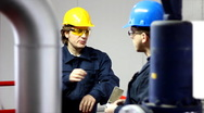 Two workers talking in a factory Stock Footage