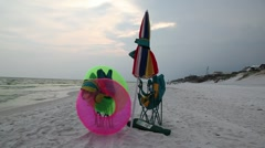 Beach Umbrella and Tubes Stock Footage
