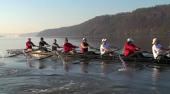 Crew boat rows with the Hudson highlands behind them - stock footage