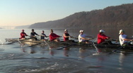 Crew boat rows with the Hudson highlands behind them Stock Footage