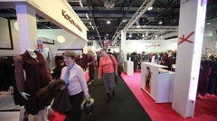 Buyers walks in exhibition hall on CPM Collection Premiere - stock footage