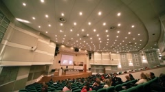 People in auditorium during CPM Collection Premiere in Expo center - stock footage