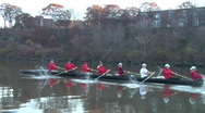 Eight man crew boat rows near shore Stock Footage