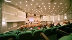 People sits in conference hall on CPM Collection Premiere - stock footage