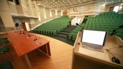 View from stage of empty conference hall with seats Stock Footage
