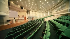 empty conference hall with green seats and big screen - stock footage