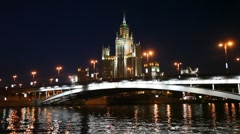 River with bridge and Skyscraper on Kotelnicheskaya Enb in Moscow Stock Footage