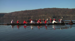 Two crew boat teams race down river Stock Footage