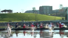 Two crew boat teams rows near shore Stock Footage
