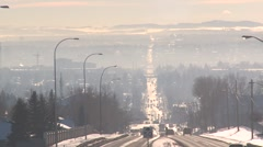 Traffic and smoggy skies over city, long shot Stock Footage