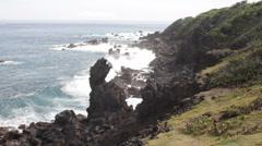 Waves crashing onto black rocks Stock Footage