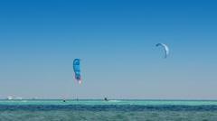 Kite surfing - surfers on blue sea surface - timelapse Stock Footage