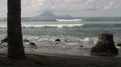 Black beach of St Kitts looking toward island Stock Footage