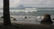 Stock Video Footage of Black beach of St Kitts looking toward island