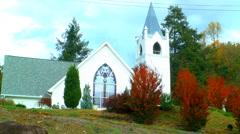 White wedding chapel autumn Stock Footage