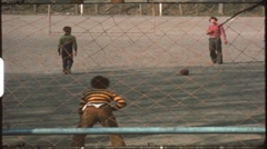 Children in the 1970s playing penalty shootout (vintage 8 mm amateur film) Stock Footage