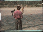 Stock Video Footage of Children in the 1970s playing penalty shootout (vintage 8 mm amateur film)