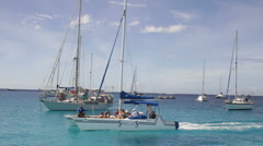 Boats on the aqua Caribbean Sea Stock Footage