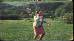 Mother playing shuttlecock in the 1970s (vintage 8 mm amateur film) Stock Footage