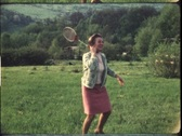 Stock Video Footage of Mother playing shuttlecock in the 1970s (vintage 8 mm amateur film)