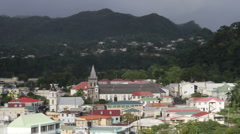Church steeple protrudes from cityscape, Dominica Stock Footage
