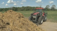 Stock Video Footage of Tractor turning manure pile 02
