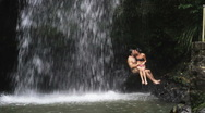 Stock Video Footage of Couple/Man under waterfall