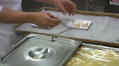 Baker arranges plate of desserts Stock Footage