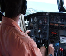Pilot flying small plane Stock Footage