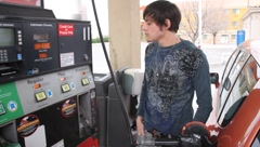Teenager Pumping Gas Stock Footage