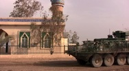 Stock Video Footage of Stryker drives past mosque in Iraq