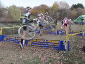 Cyclocross. Running over hurdles. SD. Stock Footage