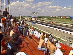 Motorsports,  Drag racing, funny car pass from grandstand POV Stock Footage