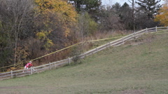 Cyclocross. Running uphill. Stock Footage