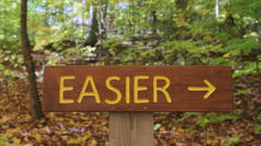 Easier and Harder signs. Two shots. Stock Footage