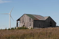 Modern windmill. Old barn. SD. - stock footage