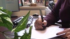 Writing paperwoks - stock footage