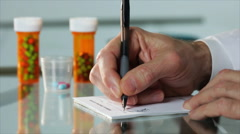 doctor writing a prescription - stock footage