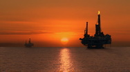 Stock Video Footage of Off-shore Oil Drilling Platform at Sunset