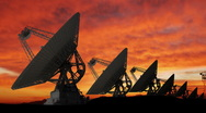 Stock Video Footage of Large Array of Satellite Dishes at Sunset
