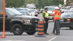Police roadblock on busy street - stock footage