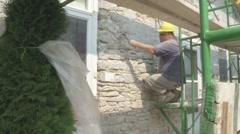 Stone mason restoring house MS/CU Stock Footage