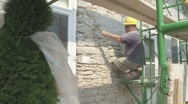 Stock Video Footage of Stone mason restoring house MS/CU