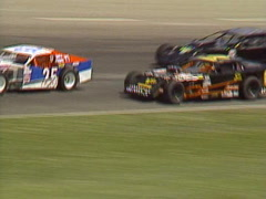 Motorsports, IMCA modifieds stock car race follow shot tight in banked corner Stock Footage