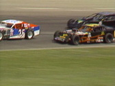 Stock Video Footage of motorsports, IMCA modifieds stock car race follow shot tight in banked corner