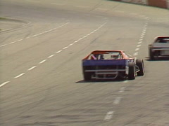 Motorsports, IMCA stock car race, back straight reverse angle Stock Footage
