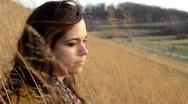 Pan of Girl sitting in Wheat Field Stock Footage