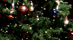 Christmas tree ornaments dolly into tree Stock Footage