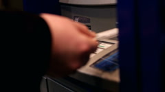 Man inserts and removes ATM card from machine - stock footage