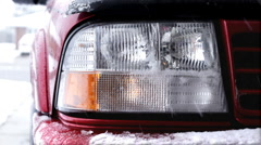 Headlight on Car with snow falling Stock Footage